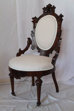 Victorian Solid Walnut Renaissance Revival Side Chair, The Carvings Are Reminiscent Of John Jelliff Of Newark, N.J., A Highly Regarded Cabinetmaker In The Victorian Era. The Chair Has An Ornately Carved Crest With Central Medallion Of A Woman With Additional Bold Carvings and Roundels Extend Along The Corners Of The Back.   c.1860's-1870's