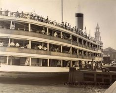 Digital image of sepia-tone photo of people boarding a dayliner for DeSapio Democratic Association outing, Hoboken, no date, ca. 1945-1950. Hoboken Historical Museum.