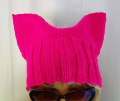 Me Too Girl Power PussyHat Project Pussy Hat Slouchy Hat Made with bright fluorescent neon pink soft stretchy yarn, this popular hat is available in size S, M, and L. Circular Knitting Machine, Popular Hats, Pink Soft, Weaving Textiles, Knitting Wool, Slouchy Hat, Winter Accessories, Hat Making, Girl Power