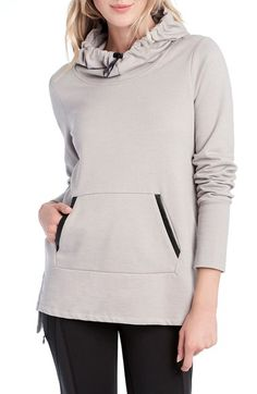 Cozying up with a large cup of hot cider, in this cotton-blend fleece hoodie.
