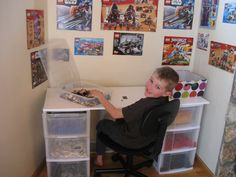 Lego desk with storage and set pics on wall. REALLY great idea!