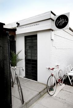 ∆ Simple, minimalistic studio entrance. Complimented nicely by the bare-bones road bikes, probably fixed gears, huh?