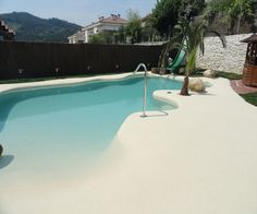 Swimming pools with beach entry design have become more and more popular today. It makes a pool look way more attractive with its unique style. Zero Entry Pool, Beach Entry Pool, Backyard Beach, Small Backyard Pools, Backyard Pool Designs, Beach Pool, Swimming Pool Landscaping, Natural Swimming Pools, Outdoor Swimming Pool