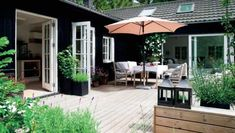 L-shaped house with french doors opening out on to beautiful courtyard. Outdoor Spaces, Outdoor Living, Outdoor Decor, Black House, Exterior Paint, Black Exterior, Backyard Patio, Cabana, House Painting