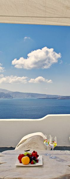 Overlooking the sparkling sea of #Santorini.