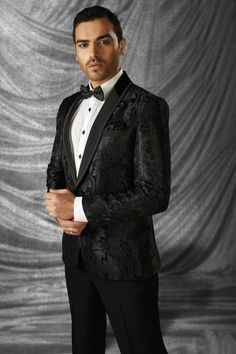 Give an herosiam look on your wedding eith this beautiful designed Gorgeous Black imported mesmeric prince suit with shawl lapel and full sleeves wuth self embossed pattern which gives an striking look to the weare and it Is ideal for rceptions and parties.Suit Collar : Shawl LapelSuit Colour : BlackSuit Fabric : italian silkSuit Sleeves : Full SleevesSuit Work : Self embossedOccasion : No