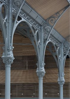 Studio Milou has been in charge of the rehabilitation of the Carreau du Temple, one example of Paris's great tradition of steel-and-glass architecture. Architecture France, Architecture Design, Architecture Art Nouveau, Industrial Architecture, Shop Buildings, Roof Trusses, Steel Art, Metal Structure, Glass Roof