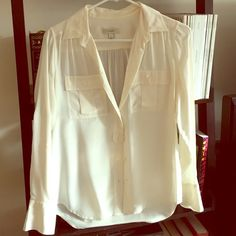 Jcrew cream blouse Jcrew cream blouse. There is a small spot near where my finger is pointing but you can't see it unless you really look in the light. J. Crew Tops Button Down Shirts