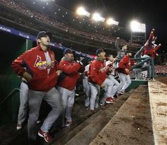 The Cardinals' dugout reacts to the game-winning two-run single by Pete Kozma in the ninth inning during Game 5 of the National League Division Series between the St. Louis Cardinals and the Washington Nationals on Friday, Oct. 12, 2012, at Nationals Park in Washington, D.C.
