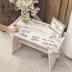 Used as a guest book stand or as a stand-alone alternative for guest signatures, this decorative rustic antiqued wood step stool can be personalized and will make a wonderful focal point at your rustic wedding receiving table. This unique guest book alternative will become a cherished wedding heirloom piece once signed by close family and friends on your wedding day: http://myweddingreceptionideas.com/personalized-rustic-white-wood-guest-book-bench.asp