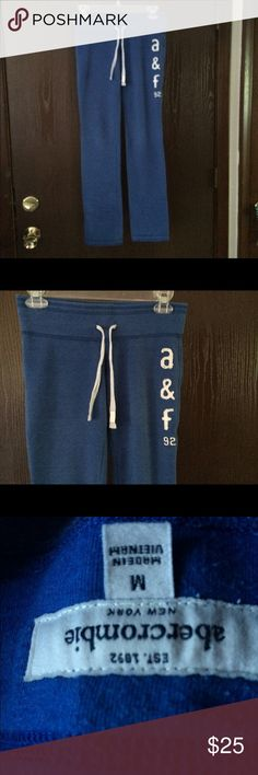 Blue yoga pants Abercrombie and Finch Blue yoga/ exercise pants with white letters and drawstring. Low rise- full length. EUC Abercrombie & Fitch Pants Track Pants & Joggers