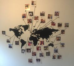 Map Photo Wall - with so many travel photos it was costly to buy individual photo frames. So I printed out Polaroid versions @ www.photobox.co.uk which handily come printed with a caption of your choice. Handy to make note of each destination!