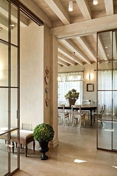 Add a dash of sophistication to your house with the help of interior or exterior french doors and softwood posts. Living Room Interior, Interior Design Kitchen, Hall Deco, Interior Barn Doors, Interior And Exterior, Steel Doors And Windows, Hanging Room Dividers, Wood Beams, Beautiful Interiors