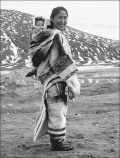 Inuit woman and baby. In many Arctic regions, a pouch is sewn onto the back of a woman's parka to hold her child.