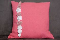 Pink pillow with crochet roses