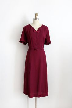 Gorgeous crepe day dress with belt from the early 1950s.