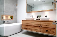Solid timber vanities can bring warmth to your #bathroom. #InteriorDesign #InteriorDecorating