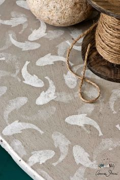 My stencil of fish randomly layered on a table using Old White over Country Grey.