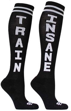 Black knee high socks with TRAIN in white lettering down one sock and INSANE on the other.
