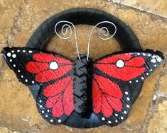 Tire Swings and tree swings hand painted and customized Tired Animals, Painted Tires, Hand Painted, Red Butterfly, Butterfly Wall, Reuse Bottles, Tire Craft, Tire Swings, Kids Swing
