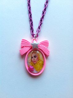 Lady GaGa Necklace on a pink bow cameo, purple metal chain, blue and pink stars. Poker face, born this way, bad romance, telephone by AngelicConcepts, $14.00