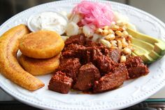 Carne colorada is an annatto or achiote marinade meat dish from Ecuador, this traditional recipe is made with beef or pork cooked in a bright red marinade sauce.