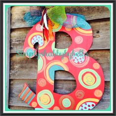 . Personalized Initial Wood door hanger These letters are hand painted with acrylic paint & accented with glitter puffy paint . they are made to your order, so feel free to customized any way you want. They are sealed to withstand the weather. All letters include a Mesh or