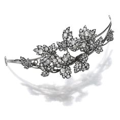 DIAMOND TIARA, LATE 19TH CENTURY Designed as interweaving branches, set with cushion-shaped, circular-cut and rose diamonds, inner circumference approximately 195mm, three leaves and three branches detachable, accompanied by brooch and ear clip fittings.