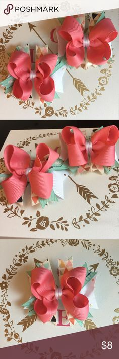 Boutique Stacked Pigtail Hair Bows - Set of 2 Handmade Boutique stacked pigtail hairbows- set of 2  Top off her favorite outfit with this set of super trendy pigtail bows!  This set is made using grosgrain ribbon in both solid, gold accented, and modern triangle prints.  Each one measures 3 inches and comes on a lined alligator clip.  Colors: Coral, Mint, Pink, white, black, gold  Prints: Modern triangle, arrows, gold polka dot   Bundle and save! Handmade Accessories Hair Accessories