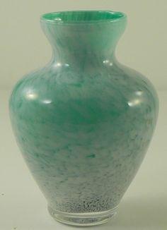 Murano Art Glass Green & White Vase  http://www.ebay.com/itm/Murano-Art-Glass-Green-White-Vase-/370616133610?pt=LH_DefaultDomain_0=item564a7167ea#
