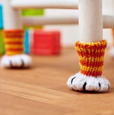 Free Knitting Pattern for Chair Paws - Chair socks to protect floors and furniture legs are inspired by our feline friends. Designed by Nicola Valiji.