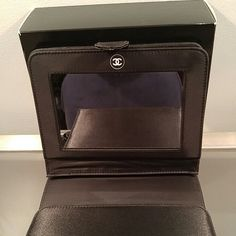 ! CHANEL SATIN  VANITY ! BRAND NEW! They just don't make these anymore! Perfect for at home use vanity case, holds your brushes and products and has a standup Chanel mirror, which can also be detached. Great for travel too. Amazing CHANEL ACCESSORY. CHANEL Accessories