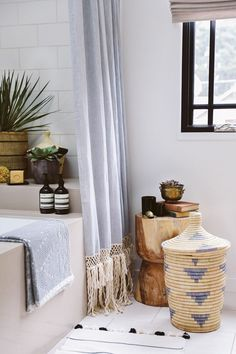 Get your bathroom ready for spring by adding unique storage options. Want to find out other ways to makeover your bathroom? Check out 13 Easy Ways to Freshen Up Your Bathroom. #bathroom #interiors #tips #makeover #affordable #storage #basket