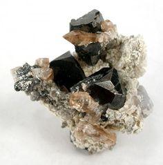 Bixbyite with Topaz on a Rhyolite matrix from Juab, Utah