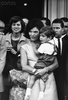 79-Eunice Kennedy Shriver, and Jacqueline Kennedy holding John Kennedy Jr.