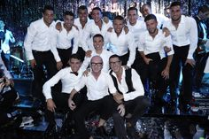 "Domenico Dolce and Stefano Gabbana with all the football players who attended the ""Campioni"" launch event"
