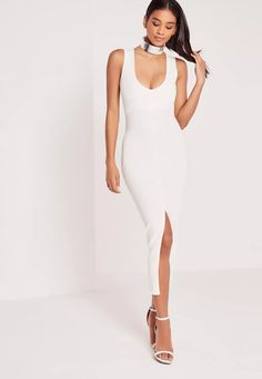 Take the plunge and make sure you're the hottest at any event in this luxe midi dress. In a versatile white hue, chic split side and a daring plunge neckline, this sweet piece will turn everyone's heads. Team with barely there heels and a c...