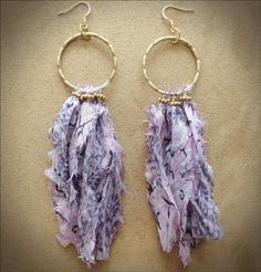 These earrings are lavender toned recycled silk saris hanging from a beautiful bronze hammered hoop and wire wrapped with bronze seed beads. There are two pairs available and color may vary slightly depending on the silk, no pair can be identical.