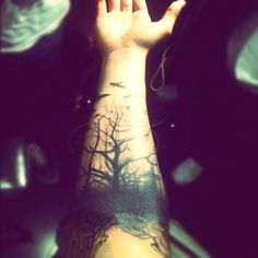scary forest forearm tattoo