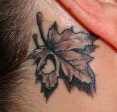 Behind the ear tattoo ... Canadian Maple Leaf With Heart Cut Out
