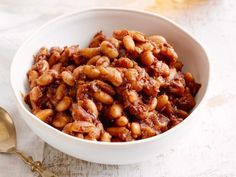 Recipe of the Day: Giada De Laurentiis' Italian-Style Baked Beans Elevate canned cannellini beans to cookout-worthy heights by cooking them down with dark beer, brown sugar, balsamic vinegar and molasses until rich and sticky in the oven.""