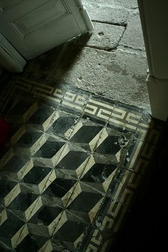 Beautifully aged Nadia tile in black and white (but this time mainly in black). Great to see that the older it gets, the more interesting the tile becomes for bespoke colours see http://www.terrazzo-tiles.co.uk/nadia-grey-black-encaustic-cement-tile.html