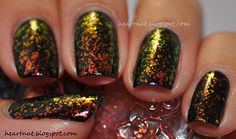 black polish with gold flakies! I'm gonna use Essie Luxe Effects topcoat to do this!