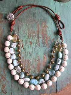 Layers of sky blue amazonite gemstones, creamy howlite and Swarovski crystal pearls combine for this fab multi-strand bohemian statement necklace.