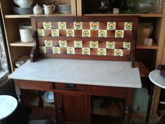 Found this awesome antique wash stand at a local resale shop.  Love it!  Marble top and tile back are both practical and gorgeous.  Let's add a simple white sink...