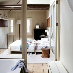open plan bathroom separated by glass instead of wall