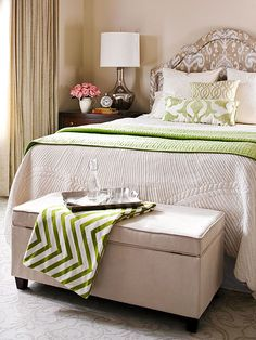 Earth tones with green secondary color like ours - green throw at end of bed would be a good idea for summer to tie in chair fabric.