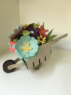 My take on a wheelbarrow made using the Berry Basket die.  Crumb Cake wheelbarrow; flowers from the Flower Fair die in Mint Macaron, Blackberry Bliss, Hello Honey, and Calypso Coral.  Leaves are Old Olive.