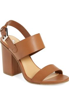 Sleek cognac leather straps make this block-heel sandal a versatile, yet chic pick for any outfit.