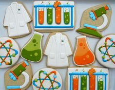 Science / scientist decorated cookie collection - microscope, beaker, labcoat, experiment, atom. Iced biscuits.